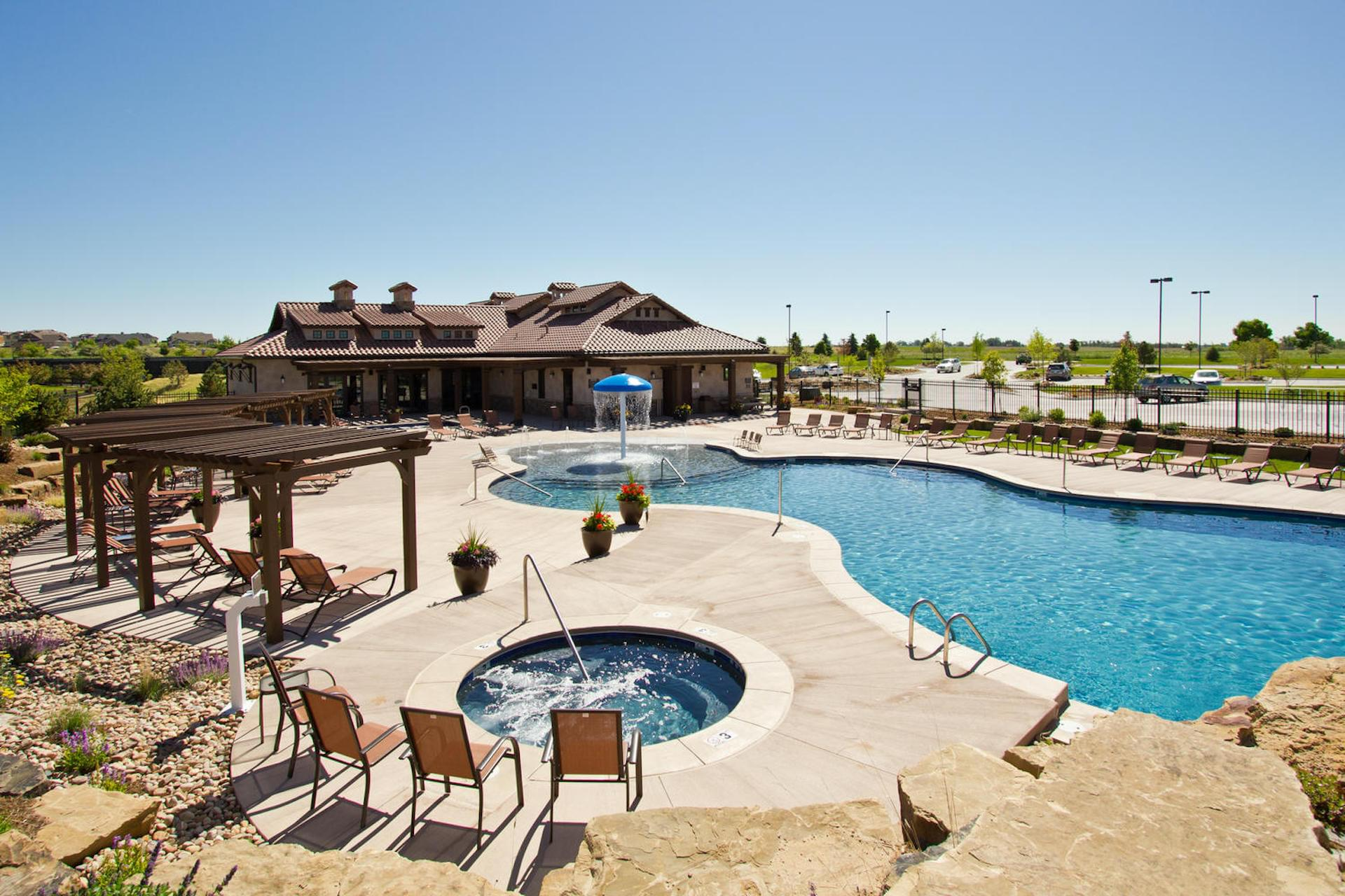 Pool. Harmony Townhomes New Homes in Timnath, CO