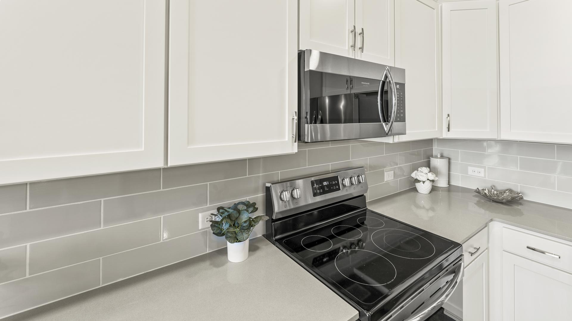 Kitchen - Not Actual Home - Finishes Will Vary . New Home in Loveland, CO