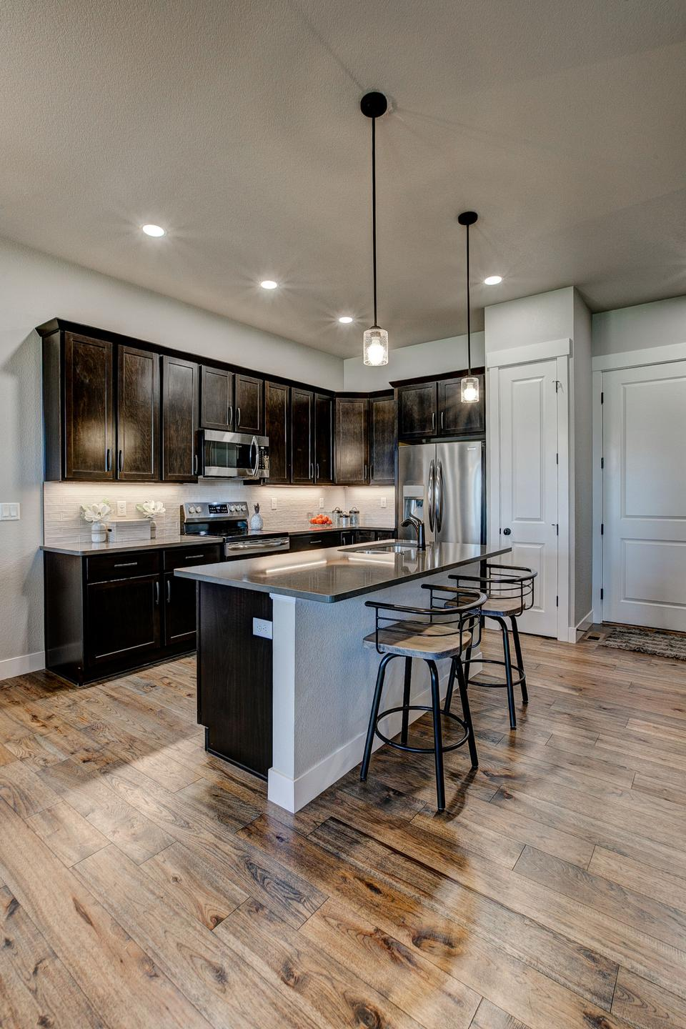 Kitchen - Not Actual Home - Finishes Will Vary . 1,738sf New Home in Windsor, CO